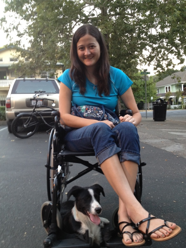 Me in my wheelchair in Calistoga, CA in September 2012. This dog just came wandering over and plopped down next to me. Pretty cute.