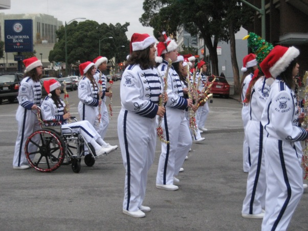 "Me ""marching"" (more like wheeling) in the Oakland Children's Christmas parade with my high school marching band in 2010. Despite my limitations, I was the flute section leader."