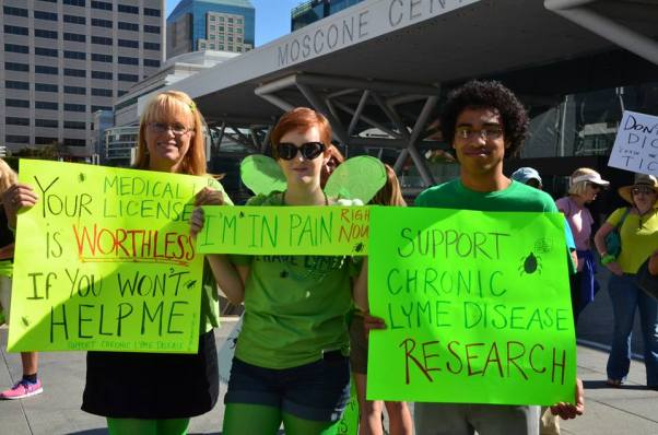 Protesters and their signs. Photo courtesy of Lymedisease.org
