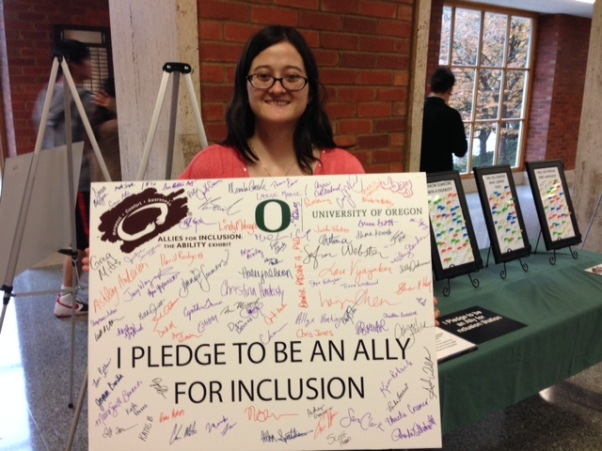 At the end of the exhibit, visitors were encouraged to sign a pledge to be an ally. Here I am holding the board at the end of the exhibit's run. So many allies!